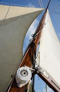 boat standing and running rigging - mainsail,backstay,pulley blocks,winch - stock photo