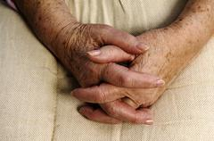 Wrinkly hands of an old woman, 80 years Stock Photos