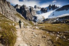 hikers in tre cime di lavaredo or drei zinnen region in autumn, dolomite alps - stock photo