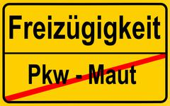 city limits sign with the words freizuegigkeit and pkw - maut, german for fre - stock photo