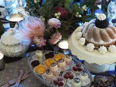 still life of a coffee table with petit fours in an elegant ambience - stock photo