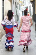 Spanish women dressed in traditional costume, seen from behind, at the feria  Kuvituskuvat