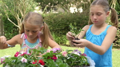 Two cute little girls planting smile at camera Stock Footage