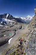 hiker ascending mt tschenglser hochwand or croda di cengles over the via ferr - stock photo