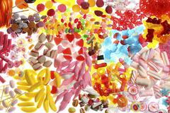 Clear plastic bags with a variety of fruit gums, marshmallows, candies, lolli Stock Photos