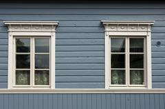 Two windows of a finnish log cabin in the old town of porvoo, finland, europe Kuvituskuvat