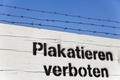 Stock Photo of plakatieren verboten, german for no bill-sticking!, lettering on a site fence