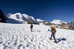 mountaineers during the ascent to mt piz palue on pers glacier, mt piz palue  - stock photo