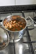 Cooking beans and endive, traditional southern italian dish Stock Photos