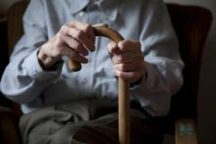 Old man, male hand gripping a walking stick, nursing home, retirement home, b Stock Photos