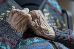 Hands of an old person showing veins, nursing home, retirement home Stock Photos