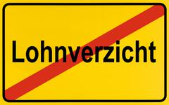 City limits sign with the word lohnverzicht, german for wage cuts, symbolic i Stock Photos