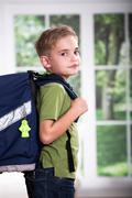 a first grader school boy with school bag - stock photo