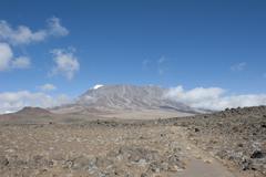 View across the kibo saddle to the summit of mt kilimanjaro, marangu route, t Stock Photos
