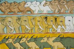 theravada buddhism, naive murals with cattle, elephants and water buffalo at  - stock photo