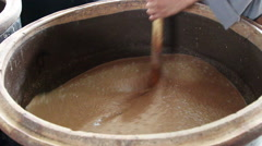 Chinese traditional wine making technique: stirring and fermentation process Stock Footage