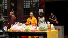 Monks holding Ghost Festival Dharma assembly in temple - stock footage