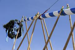maypole being erected in gelting, district of bad toelz-wolfratshausen, upper - stock photo