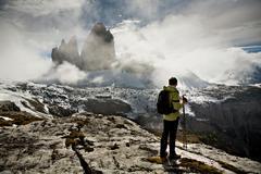 hiker in tre cime di lavaredo or drei zinnen region in autumn, dolomite alps, - stock photo