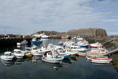 harbour, stykkið, island in an archipelago, sugandisey island at back, stykk - stock photo