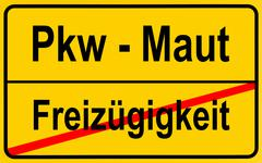 city limits sign with the words pkw - maut and freizuegigkeit, german for car - stock photo