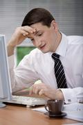 Stock Photo of a young businessman in the office
