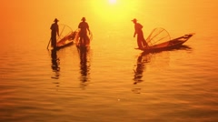 Myanmar, inle lake. fishermen on vintage boats moved with legs Stock Footage