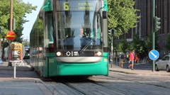 Helsinki City centre with its famous green Trams and many Pedestrians - stock footage