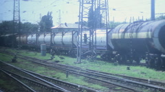 Looking through coach window, freight trains industrial district Stock Footage