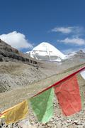 tibetan buddhism, colorful prayer flag, snow-capped sacred mount kailash, gan - stock photo