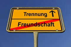 city limit sign, symbolic image for the way from freundschaft to trennung, ge - stock photo