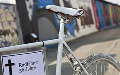 white bicycle as a memorial for cyclists who died in traffic accidents, berli - stock photo