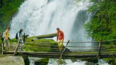 Tourists on a bamboo bridge on the background of a waterfall. doi inthanon na Stock Footage