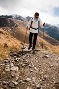 woman hiking in drei zinnen, tre cime di lavaredo area in dolomite alps, sout - stock photo