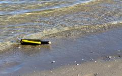 Treasure map in the bottle on the beach Stock Photos