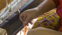 Woman making cloth on an old loom. laos, luang prabang Stock Footage