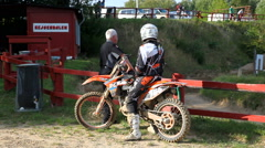 Motocross course with dirt bikes racing against each other - stock footage