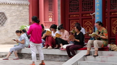 Female followers changting and praying in temple Stock Footage
