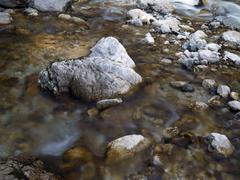 Boulders and rocks in the river bed of the soca river, soca valley near trent Stock Photos