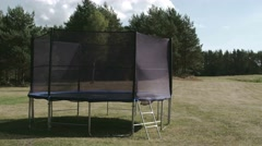 A small size trampoline on the backyard of the house fs700 odyssey 7q 4k Stock Footage