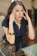 Woman with a headache Stock Photos
