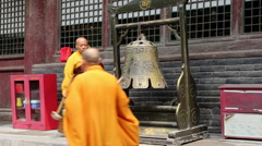 Monk knocking bell in temple Stock Footage