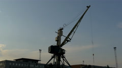 Big crane on standby on a dusky afternoon in the port gh4 4k Stock Footage
