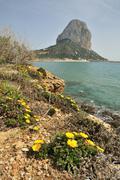 Distinctive rock peñón de ifach, landmark of calpe, costa blanca, spain, eu Stock Photos