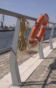 Stock Photo of lifebuoy hanging on a rail, port of hamburg, hafencity, hamburg, germany, eur