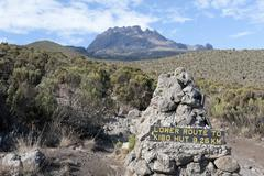 Trekking, sign, route to kibo hut, near the horombo huts, mt mawenzi at back, Stock Photos