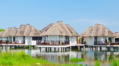 Bungalows on the water's edge. tranquil place to stay. Stock Footage