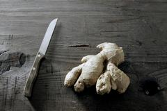 Ginger (zingiber officinale) rhizome on a rustic wooden surface Stock Photos