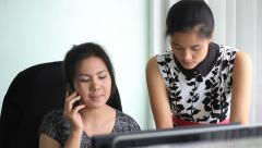 Two Asian Office Workers Hard At Work - stock footage