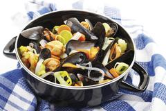mussels and vegetable in a saucepan - stock photo
